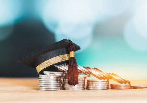 Education Graduate study scholaship concept : Congratulations graduates on top stacks of coins on wood table color background. Ideas Educational for successs study or business have to use many Money